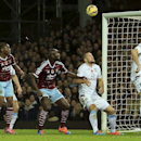West Ham United's Andy Carroll, left, makes an attempt at goal during their English Premier League soccer match against Aston Villa at Upton Park, London, Saturday, Nov. 8, 2014