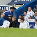 Chelsea's manager Jose Mourinho gestures to his player Frank Lampard after he was substituted, as he watches his team play during their English Premier League soccer match between Chelsea and Stoke City at Stamford Bridge stadium in London, Saturday, Apri