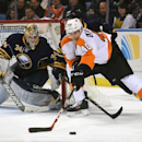 Buffalo Sabres goaltender Michal Neuvirth (34), of the Czech Republic, eyes the puck as Philadelphia Flyers center Vincent Lecavalier (40) battles in front during the second period of an NHL hockey game Saturday, Jan. 17, 2015, in Buffalo, N.Y The Associa