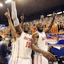 Florida forward Will Yeguete (15) and center Patric Young (4) celebrate after Florida defeated Kentucky 84-65 in an NCAA college basketball game Saturday, March 8, 2014 in Gainesville, Fla. (AP Photo/Phil Sandlin)