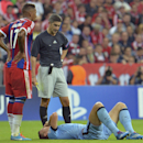 Manchester City's Edin Dzeko lies injured on the pitch during the Champions League group E soccer match between Bayern Munich and Manchester City in Munich, Germany, Wednesday Sept.17,2014