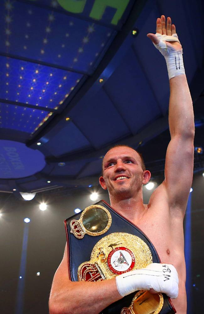 In this picture taken Saturday June 7, 2014, Germany's light heavyweight WBA world champion  Juergen Braehmer celebrates after winning his  title bout against Roberto  Feliciano Bolonti of Argentina in Schwerin, eastern Germany.  Braehmer  unanimously outpointed Roberto Feliciano Bolonti of Argentina to retain his WBA light heavyweight belt on Saturday. The judges scored it 118-109, 119-108, 119-108 in favor of the 35-year-old Braehmer, a former WBO boxing  champion, who was making his second defense of the title he won by beating American Marcus Oliveira in December