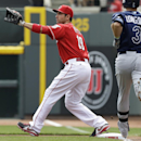 Cincinnati Reds first baseman Joey Votto catches a throw from third baseman Todd Frazier to make the out on Tampa Bay Rays' Evan Longoria (3) in the first inning of a baseball game, Sunday, April 13, 2014, in Cincinnati The Associated Press