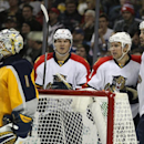 Buffalo Sabres' Jhonas Enroth (1), of Sweden, reacts to a celebration by Florida Panthers' Dmitry Kulikov (7), of Russia, Sean Bergenheim (20), of Finland, and Erik Gudbranson (44) after a goal by Bergenheim during the second period of an NHL hockey game