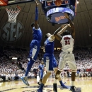 Kentucky forward Nerlens Noel (3) leaps behind teammate Kyle Wiltjer (33) as he blocks a shot by Mississippi forward Murphy Holloway (31) in the second half of an NCAA college basketball game, Tuesday, Jan. 29, 2013, in Oxford, Miss. Kentucky won 87-74. (AP Photo/Rogelio V. Solis)