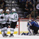Dallas Stars center Cody Eakin (20) is congratulated by teammates Tyler Seguin (91) and Jamie Benn (14) as Colorado Avalanche goalie Calvin Pickard (31) kneels in the goal during the first period of an NHL hockey game Saturday, Nov. 29, 2014, in Denver Th