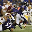 Baltimore Ravens inside linebacker C.J. Mosley, right, slips past Washington Redskins running back Alfred Morris and teammate Daryl Smith in the second half of an NFL preseason football game, Saturday, Aug. 23, 2014, in Baltimore The Associated Press