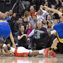 Toronto Raptors' Kyle Lowry gathers a loose ball despite the efforts of Golden State Warriors' Stephen Curry, left, and Klay Thomson during the first half of an NBA basketball game Sunday, March 2, 2014, in Toronto The Associated Press