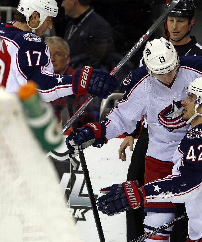 Columbus Blue Jackets' Artem Anisimov (42) of Russia, is congratulated on his goal by teammate Cam Atkinson (13) and Brandon Dubinsky (17) during the first period of an NHL hockey game against the Carolina Hurricanes in Raleigh, N.C., Monday, Dec. 23, 2013. Columbus won 4-3