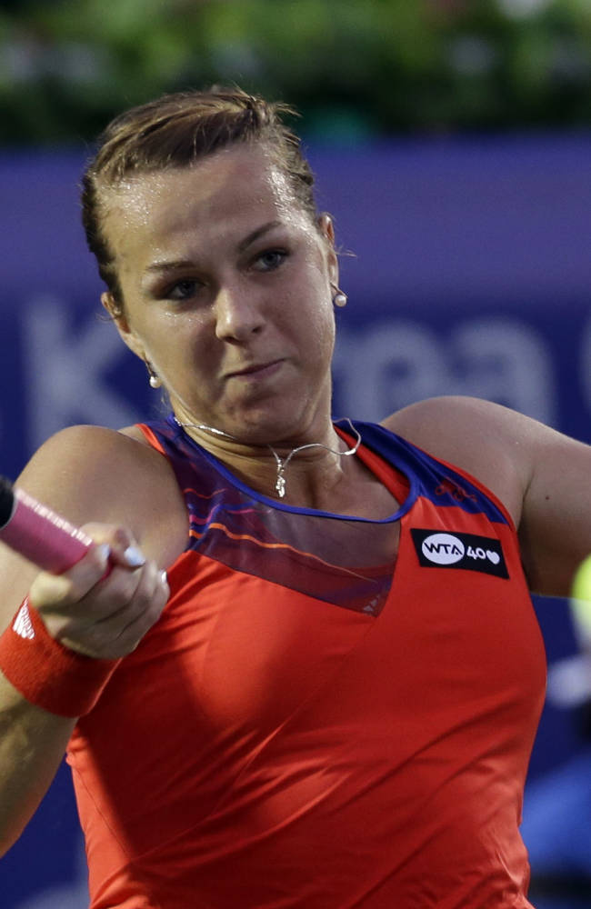 Anastasia Pavlyuchenkova of Russia returns a shot against Irina-Camelia Begu of Romania during the quarterfinal match of the Korea Open tennis championships in Seoul, South Korea, Friday, Sept. 20, 2013