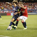 Paris Saint-Gemain's Ezequiel Lavezzi, left, battles for the ball with Manchester United's Juan Mata during International Champions Cup Play in Chicago, Wednesday, July 29, 2015. (AJ Mast / AP Images for International Champions Cup)