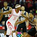 HOUSTON, TX - OCTOBER 24:  Jason Terry #31 of the Houston Rockets drives with the ball against Corey Joseph #5 of the San Antonio Spurs during their preseason game at Toyota Center on October 24, 2014 in Houston, Texas NOTE TO USER: User expressly acknowledges and agrees that, by downloading and/or using this photograph, user is consenting to the terms and conditions of the Getty Images License Agreement. Mandatory copyright notice:  (Photo by Scott Halleran/Getty Images)