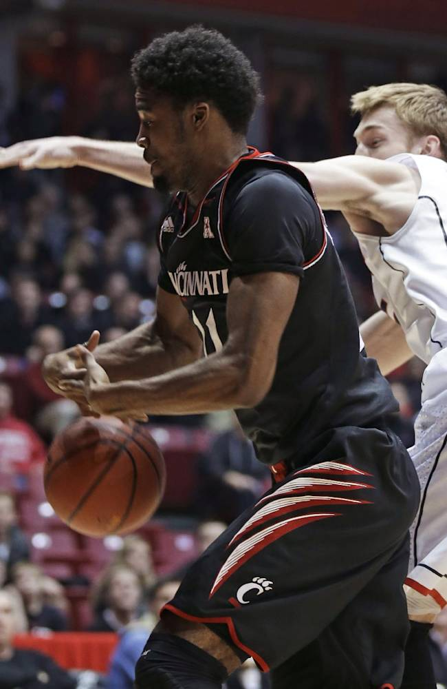 Cincinnati forward Jermaine Lawrence (11) rebounds against Connecticut guard Niels Giffey during the first half of an NCAA college basketball game, Thursday, Feb. 6, 2014, in Cincinnati