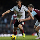 Fulham s Scott Parker, left, dribbles past West Ham United s Kevin Nolan, right, during their English Premier League soccer match in London, Saturday, Nov. 30, 2013