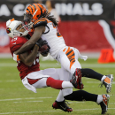 Arizona Cardinals wide receiver Ted Ginn Jr., left, is hit by Cincinnati Bengals cornerback Dre Kirkpatrick during a punt return during the first half of an NFL preseason football game, Sunday, Aug. 24, 2014, in Glendale, Ariz The Associated Press