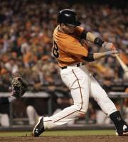 San Francisco Giants' Buster Posey connects for an RBI single off San Diego Padres' Casey Kelly in the fifth inning of a baseball game Friday, Sept 21, 2012, in San Francisco. (AP Photo/Ben Margot)