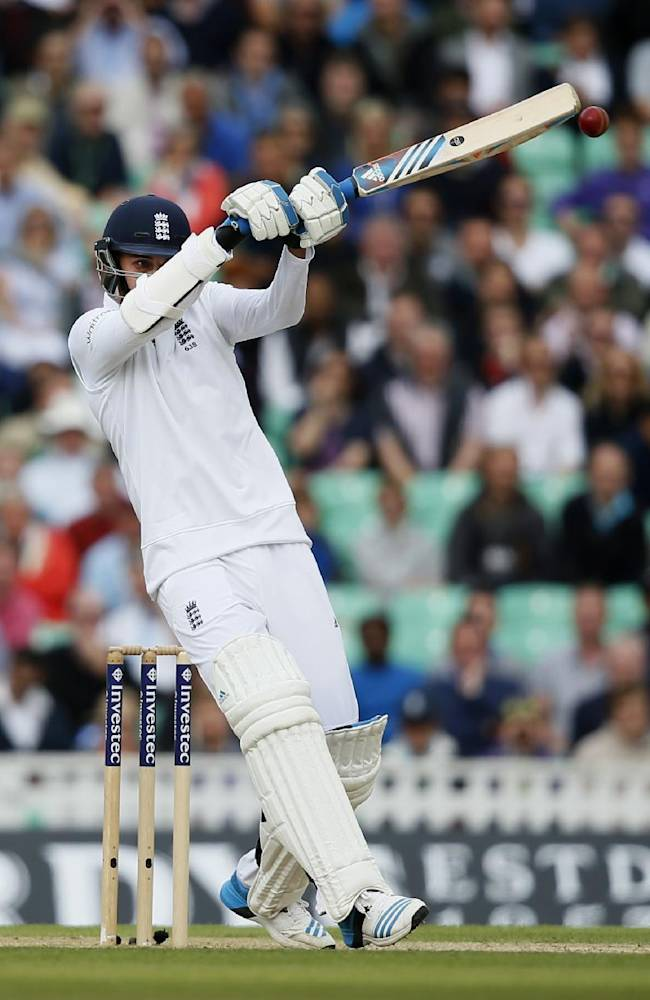 England's Stuart Broad hits a ball off the bowing of India's Ishant Sharma during the third day of the fifth test cricket match at Oval cricket ground in London, Sunday, Aug. 17, 2014