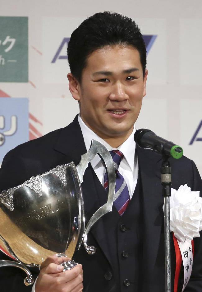 Japanese star pitcher Masahiro Tanaka of Rakuten Golden Eagles poses with his grand prix trophy during an awarding ceremony of the Japan Professional Sports Award in Tokyo, Friday, Dec. 27, 2013. All 30 major league teams have been notified that the 30-day period to sign the 25-year-old right-hander began at 1300 GMT Thursday, according to Major League Baseball spokesman Michael Teevan. Clubs have until 2200 GMT on Jan. 24 to attempt to reach an agreement with the ace