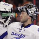Tampa Bay Lightning's Ben Bishop squirts himself with water after giving up a goal to Philadelphia Flyers' Brayden Schenn during the second period of an NHL hockey game, Monday, Jan. 12, 2015, in Philadelphia The Associated Press