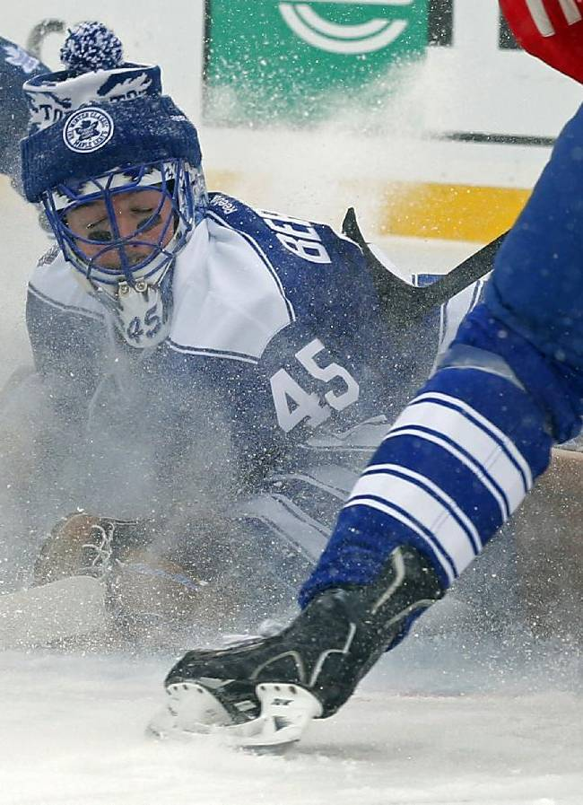 Toronto Maple Leafs goalie Jonathan Bernier (45) stops a shot on goal during the second period of the Winter Classic outdoor NHL hockey game against the Detroit Red Wings at Michigan Stadium in Ann Arbor, Mich., Wednesday, Jan. 1, 2014