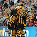 Hull City's players celebrate after Tom Huddlestone, obscured, scored against Sheffield United during their English FA Cup semifinal soccer match between Hull City and Sheffield United at Wembley Stadium, London, England, Sunday, April 13, 2014