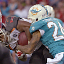 Miami Dolphins cornerback Cortland Finnegan (24) ties up Tampa Bay Buccaneers running back Doug Martin (22) on a run during the first quarter of an NFL preseason football game Saturday, Aug. 16, 2014, in Tampa, Fla The Associated Press