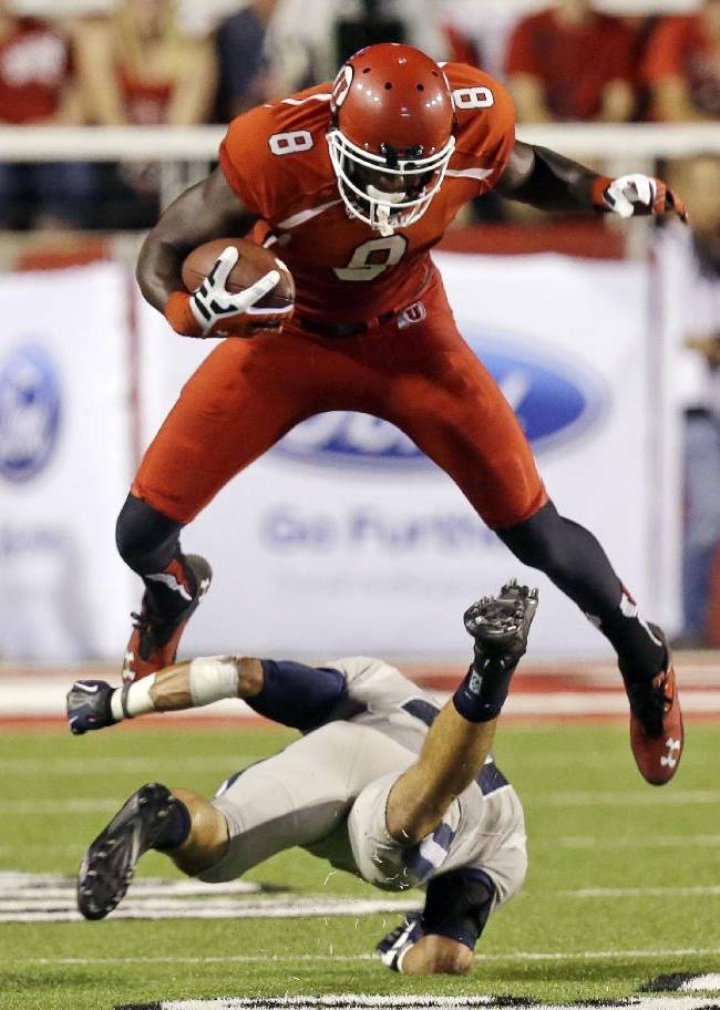 In this Aug. 29, 2013, file photo, Utah wide receiver Anthony Denham (8) leaps over Utah State safety Brian Suite (21) during the second half of an NCAA college football game, in Salt Lake City. On Saturday, Utah hosts Oregon State, a team that has struggled to find its offense after the first two games of the season. Denham had 113 yards on six catches against Utah State