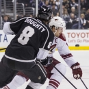 Los Angeles Kings defenseman Drew Doughty (8) and Phoenix Coyotes forward Shane Doan (19) vie for the puck during the first period of an NHL hockey game, Wednesday, April 2, 2014, in Los Angeles The Associated Press