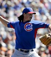 Chicago Cubs starting pitcher Jeff Samardzija throws to the San Francisco Giants during the first inning of a spring exhibition baseball game in Scottsdale, Ariz., Monday, March 10, 2014. (AP Photo/Chris Carlson)