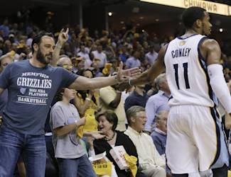 Memphis Grizzlies guard Mike Conley (11) slaps hands with a fan in the first half of Game 3 of an opening-round NBA basketball playoff series against the Oklahoma City Thunder on Thursday, April 24, 2014, in Memphis, Tenn. (AP Photo/Mark Humphrey)