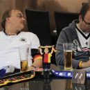German fans rest in a bar before the Euro 2012 soccer championship quarterfinal match between Germany and Greece in Gdansk, Poland, Friday, June 22, 2012. (AP Photo/Alvaro Barrientos)