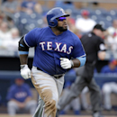 Texas Rangers' Prince Fielder watches the flight of his fly-out off a pitch from San Diego Padres starter Ian Kennedy to center field in the third inning of a spring training baseball game on Thursday, March 6, 2014, in Peoria, Ariz The Associated Press