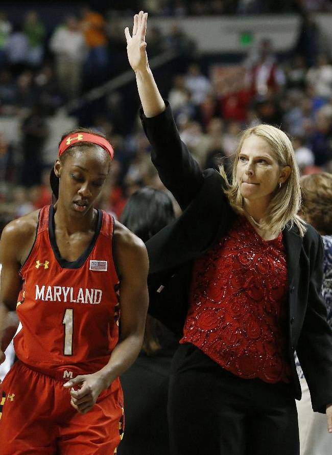 Maryland head coach Brenda Frese waves to fans after the second half of the semifinal game against Notre Dame in the Final Four of the NCAA women's college basketball tournament, Sunday, April 6, 2014, in Nashville, Tenn. Notre Dame won 87-61