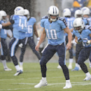 Tennessee Titans quarterback Jake Locker (10) and teammates warm up in the rain before a preseason NFL football game against the Green Bay Packers, Saturday, Aug. 9, 2014, in Nashville, Tenn The Associated Press