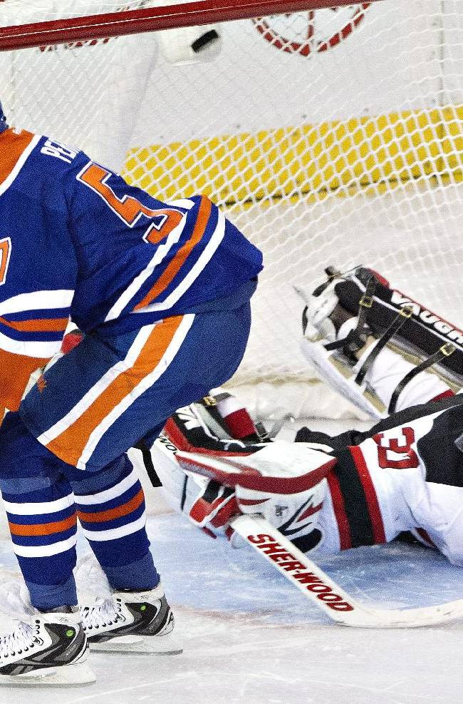 New Jersey Devils goalie Martin Brodeur (30) is scored on by Edmonton Oilers David Perron (57) during the shootout in an NHL hockey game Monday, Oct. 7, 2013, in Edmonton, Alberta. The Oilers won 5-4
