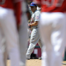 New York Mets starting pitcher Bartolo Colon looks toward first base after a single hit was by Los Angeles Angels' Howie Kendrick during the fifth inning of a baseball game in Anaheim, Calif., Sunday, April 13, 2014 The Associated Press