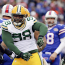 Green Bay Packers nose tackle Letroy Guion (98) celebrates a sack of Buffalo Bills quarterback Kyle Orton (18) during the first half of an NFL football game Sunday, Dec. 14, 2014, in Orchard Park, N.Y The Associated Press