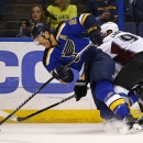 St. Louis Blues' Alex Pietrangelo, left, is checked off the puck by Colorado Avalanche's Gabriel Landeskog, of Sweden, during the first period of an NHL hockey game Monday, Jan. 19, 2015, in St. Louis The Associated Press