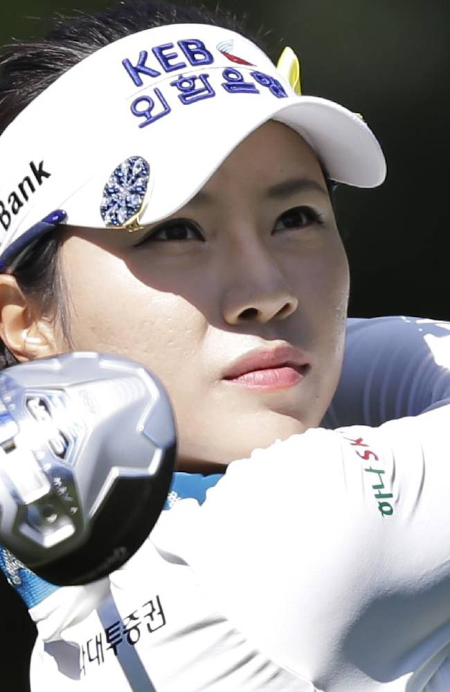 Hee Young Park, of South Korea, watches her tee shot on the ninth hole during the third round of the Kingsmill Championship golf tournament at the Kingsmill resort  in Williamsburg, Va., Saturday, May 17, 2014