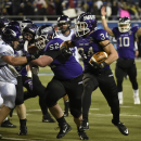 Mount Union running back Logan Nemeth (34) follows blocker Mitch Doraty (52) and scores a touchdown against Wisconsin-Whitewater, during the second half of the NCAA Division III championship college football game at Salem Stadium in Salem, Va., Friday De