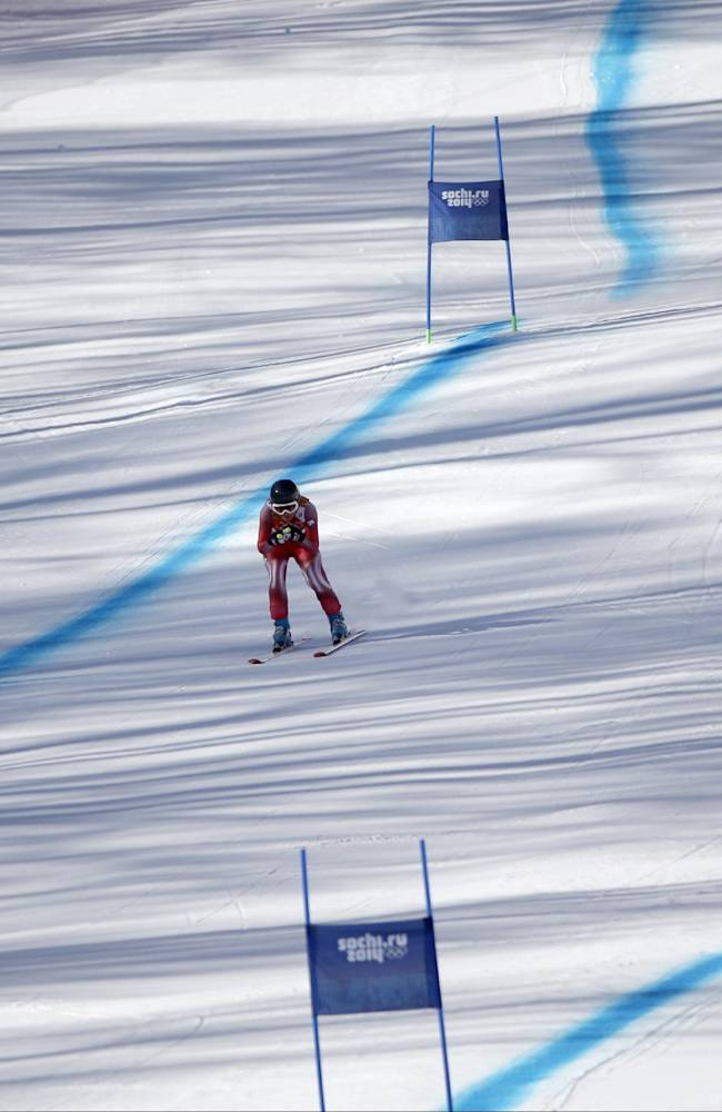 Switzerland's Fabienne Suter nears the finish area at the end of a women's downhill training run for the Sochi 2014 Winter Olympics, Friday, Feb. 7, 2014, in Krasnaya Polyana, Russia
