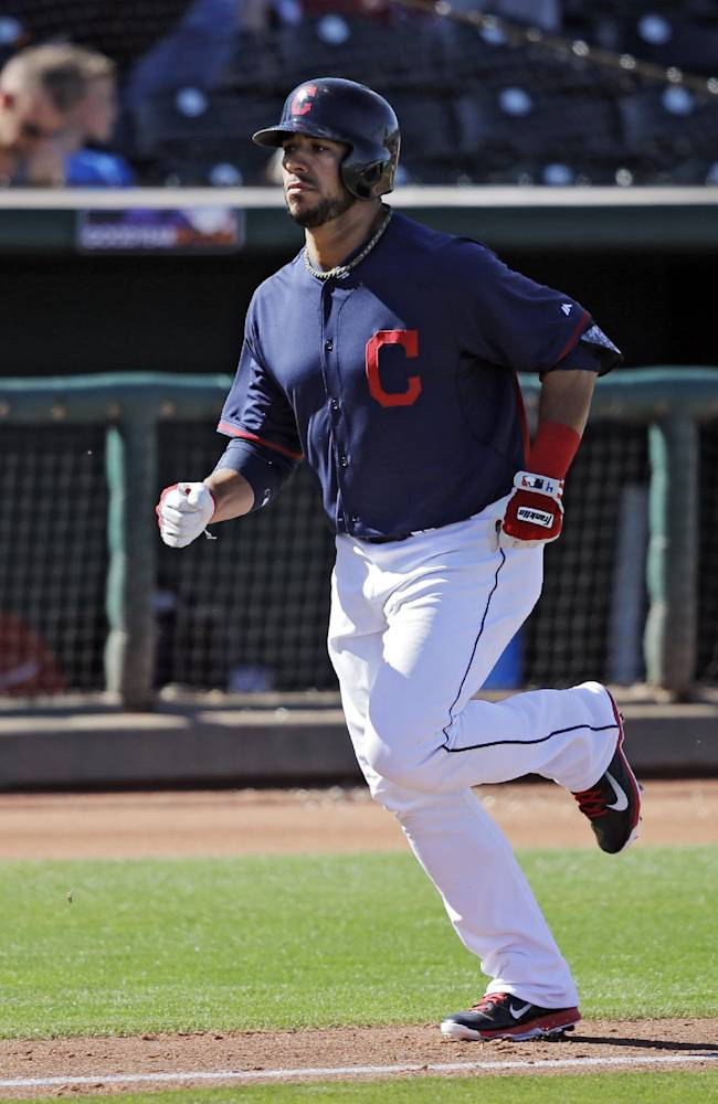 Cleveland Indians' Mike Aviles jogs home after a solo home run off Colorado Rockies deliver Adam Ottavino in the sixth inning of a spring exhibition baseball game, Saturday, March 22, 2014, in Goodyear, Ariz