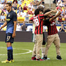 IMAGE DISTRIBUTED FOR GUINNESS INTERNATIONAL CHAMPIONS CUP - Two soccer fans grab a