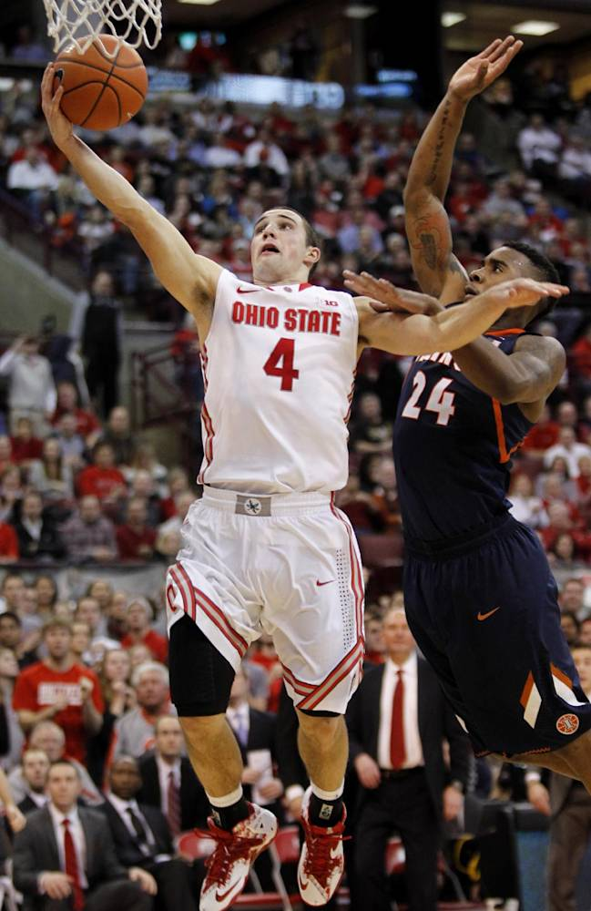 In this Jan. 23, 2014 file photo, Ohio State's Aaron Craft, left, goes up for a shot against Illinois' Rayvonte Rice during the second half of an NCAA college basketball game in Columbus, Ohio.  No. 24 Ohio State, still dogged by a bad spell in January, tries to stack together some solid wins as it heads into the Big Ten and NCAA tournaments. The next test comes Saturday against Minnesota, which beat the Buckeyes 63-53 when they went through that 1-5 downward spiral. ( AP Photo/Paul Vernon, File)