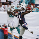 A pass intended for New England Patriots tight end Timothy Wright (81) goes incomplete as Miami Dolphins linebacker Jelani Jenkins, left, and free safety Louis Delmas, right, defend in the second half of an NFL football game, Sunday, Sept. 7, 2014, in Mia