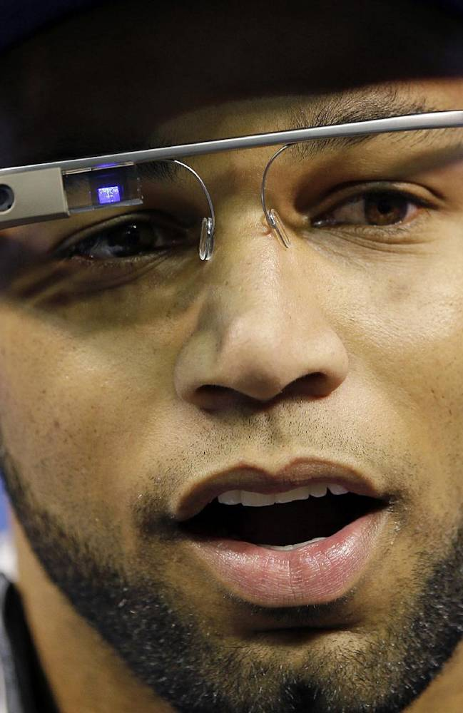 In this Jan. 28, 2014 file photo, Seattle Seahawks' Golden Tate wears Google glasses during media day for the NFL Super Bowl XLVIII football game, in Newark, N.J. The use of Glass in sports has progressed from trendy athletes dipping their toes in the water to a tool for teams looking to draw fans to arenas and stadiums, and then keep their focus on the action, instead of their omnipresent smartphones and tablets