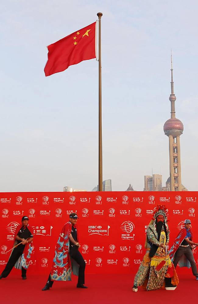 From left to right, Jason Dufner of the United States, Phil Mickelson of the United States, Ian Poulter of England, Rory McIlroy of Northern Ireland,  Justin Rose of England pose for photographers during a photo call of the HSBC Champions golf tournament Tuesday, Oct. 29, 2013 in Shanghai, China. The golf tournament will be held at Shanghai Sheshan International Golf Club from Oct. 31 to Nov. 3. (AP Photo)