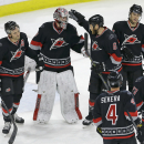 Carolina Hurricanes goalie Cam Ward is congratulated by Tim Gleason (6) and teammates following the Hurricanes' 4-1 win over the Toronto Maple Leafs in an NHL hockey game in Raleigh, N.C., Thursday, Dec. 18, 2014 The Associated Press