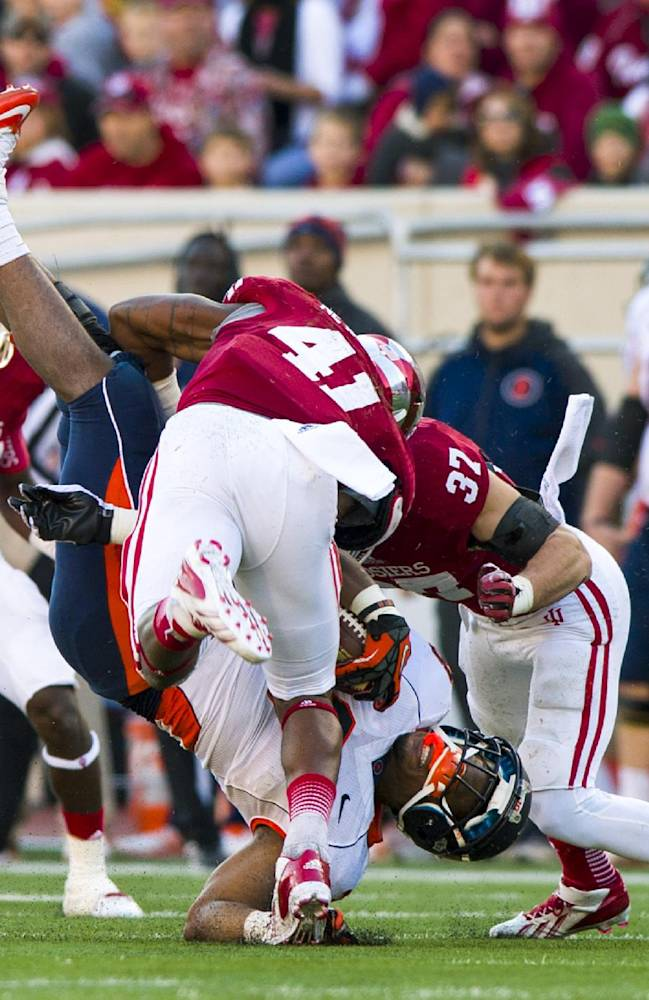 Illinois' Jon Davis (3) is thrown to the turf by Indiana's Clyde Newton (41) during the first half of an NCAA college football game, Saturday, Nov. 9, 2013, in Bloomington, Ind