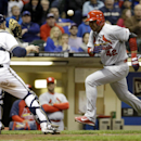 Milwaukee Brewers catcher Jonathan Lucroy gets the the to tag out St. Louis Cardinals' Jhonny Peralta at home during the fourth inning of the MLB National League baseball game Tuesday, April 15, 2014, in Milwaukee. Peralta tried to score from second on a